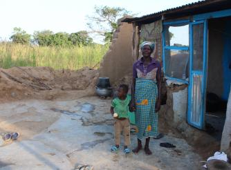 Kanpege and her son, Daniel lost a portion of their home during torrential rains in the Upper East region