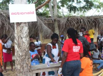 AAG Staff assisting beneficiaries in Amuman, Ga South District, Greater Accra Region